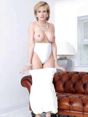 Sexy mature babe exposing her white panties and stripping off her dress