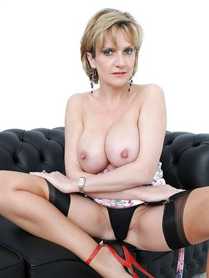 Mature lady in fancy dress doing upskirt and exposing her big tits