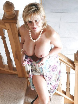 Gorgeous mature babe in fancy dress exposing her sexy ass and big melons