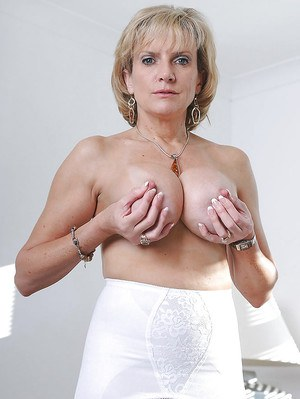 Sexy mature lady with big tits and hot ass slipping off her dress