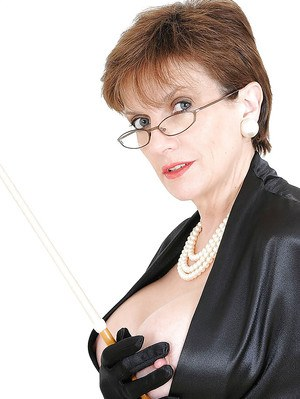 Sexy mature lady in glasses showing off her boobs and shaved pussy