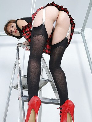 Seductive mature lady in black nylon stockings doing upskirt