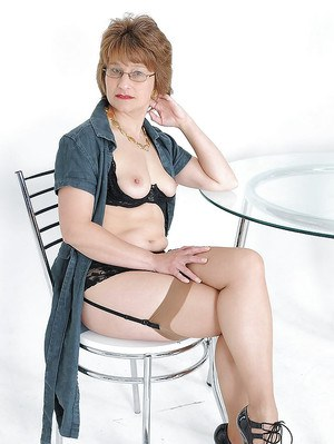 Horny mature ladies in glasses showing off their fuckable bodies