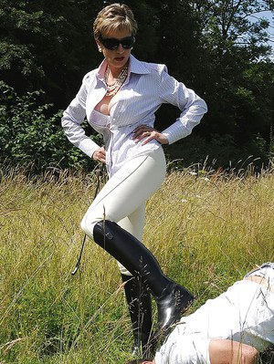 Seductive mature femdom playing with her human pet outdoor