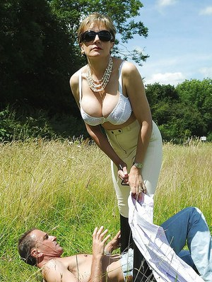 Seductive mature femdom stripping and torturing her boyslave outdoor