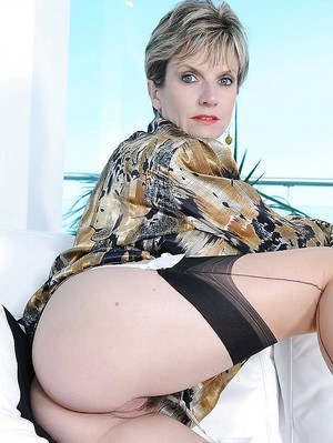 Seductive mature lady in stockings showing off her fanny and cunt