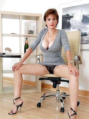 Seductive mature lady in cotton dress spreading her slender legs