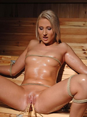 Bound babe Viktoria Diamond gets her shaved pussy clamped with clothespins