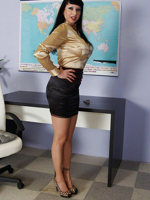Hot mature secretary in stockings uncovering her big tits and sexy ass