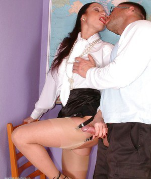 Curvaceous mature teacher in glasses jerks and fucks a student's cock