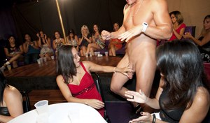 Horny hotties take turns sucking a malestripper's cock ar the party