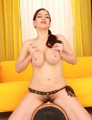 Busty babe with hairy slit stripping and riding a fucking machine