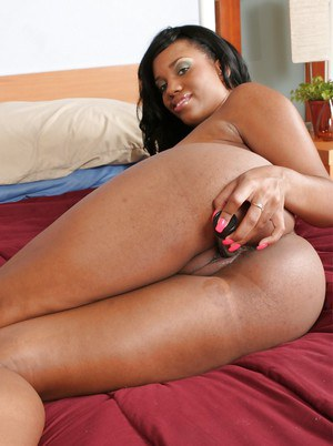 Lusty ebony babe Sydnee Capri stripping and masturbating her shaved cunt