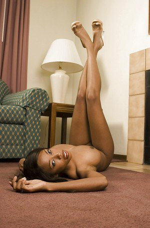 Seductive ebony babe with big natural tits Amber Fox posing naked