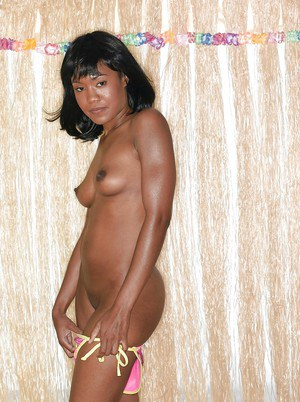 Young ebony hottie with tiny tits stripping and playing with her toy