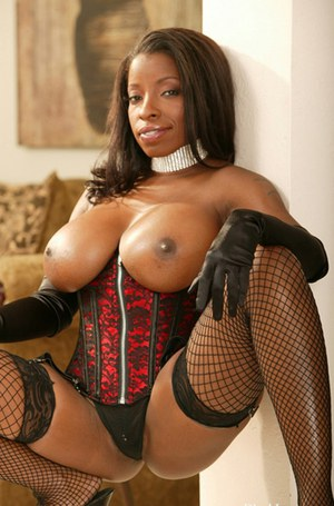 Busty ebony MILF Vanessa Blue posing in stockings and lingerie
