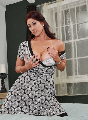 Sexy MILF with big tits Tiffany Mynx stripping off her dress and lingerie