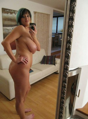 Chubby girlfriend Lola Stone stripping and showing off her massive jugs