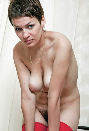 Short haired mature babe with big tits toying her unshaven cunt