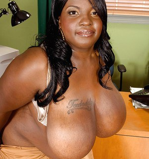 Ebony plumper Diamond Knights showing off her huge boobs and big ass