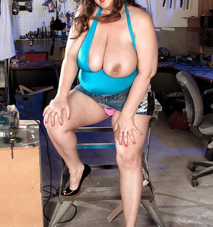 Mature plumper flashing her panties and showing off her big boobs