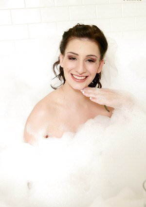 Hot babe September Carrino playing with soap sud in the bath