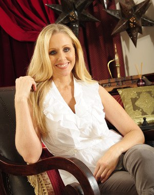 Lusty MILF Julia Ann stripping off her clothes and playing with her toys