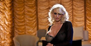 Gorgeous MILF Stormy Daniels stripping and posing on the bed