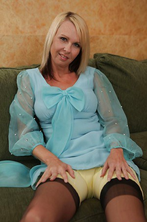 Stunning blonde MILF in stockings stripping and exposing her big tits