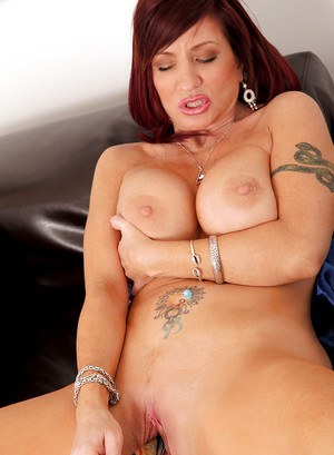 Hot MILF Brittany Blaze stripping and masturbating her cunt with a toy