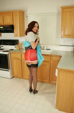 Busty mature babe in stockings Abigail Fraser stripping in the kitchen