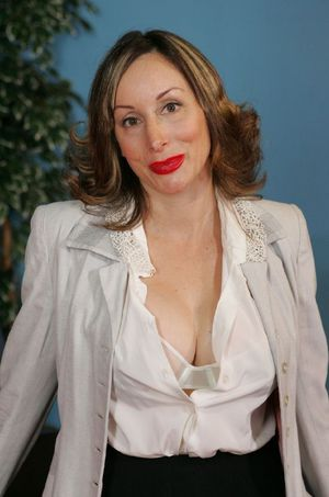 Stunning mature babe Abigail Fraser stripping in the office