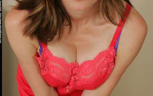 Horny mature babe Abigail Fraser stripping and playing with a huge dildo