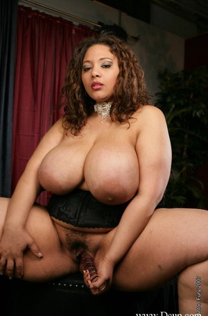 Ebony babe Lady Spice showcasing her fatty boobs and toying her cunt