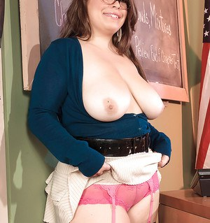Plump babe in glasses Lola Lush uncovering her huge flabby boobs