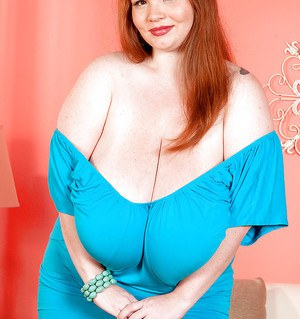 Redhead fatty babe Anorei Collins uncovering her giant flabby boobs