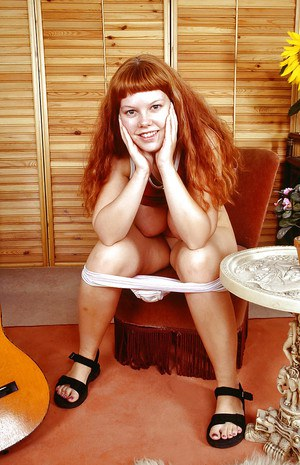 Fatty redhead babe with massive tits stripping and toying her muff