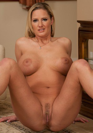 Curvy MILF on high heels Zoe Holiday stripping off her clothes