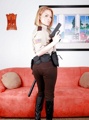 Hot babe in police uniform Krissy Lynn stripping and spreading her legs