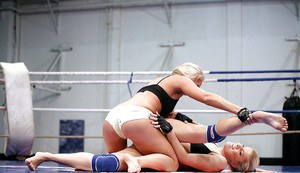 Gorgeous sporty lesbians fighting and pleasuring each other in the ring