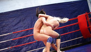 Sporty lesbians punching and grasping each other in the ring