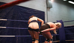 Lusty lesbian Blond Cat gets her pussy fisted after a catfight