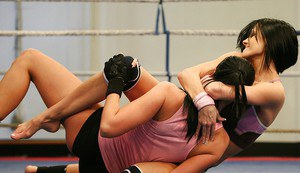 Smoking hot brunette sporty babes pleasuring each other after wrestling
