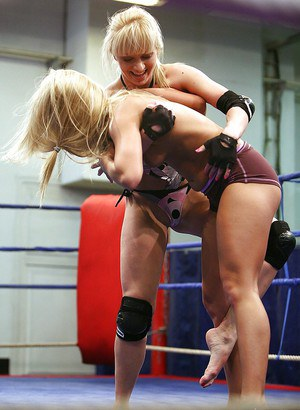 Lusty lesbians fighting and playing with their toys in the ring