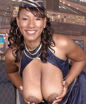 Seductive ebony MILF Africa Sexxx uncovering her massive flabby tits