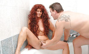 Lusty redhead granny sucks and fucks a hard cock in the bath
