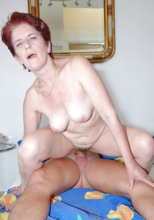 Short haired redhead granny gets slammed hardcore by a younger guy