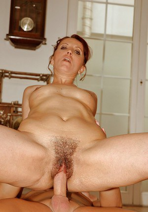 Redhead mature babe gets her trimmed cunt fisted and nailed hardcore
