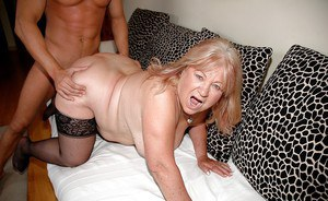 Chubby granny in stockings gives a blowjob and gets fucked by a younger guy