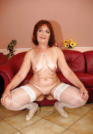 Fatty granny strips to her stockings to expose her unshaved cunt